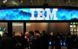 Visitors crowd an IBM stand at an IT fair in Hanover, Germany