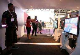 Visitors test the Sony Playstation Move at the 2010 E3 in Los Angeles