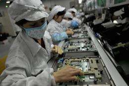 Workers assemble electronic components at Foxconn's factory in Shenzhen in 2010