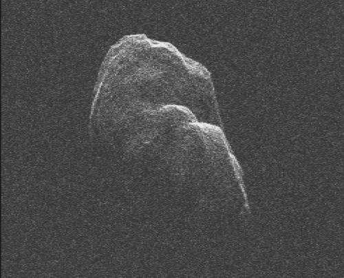 Asteroid Toutatis slowly tumbles by earth