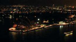 File photo shows the Sydney Opera House with its lights turned off to mark Earth Hour on March 26 last year