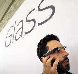 444f8875b27 Google co-founder Sergey Brin talks on the phone as he wears Google s new  Internet-connected glasses at the Google I O conference in San Francisco