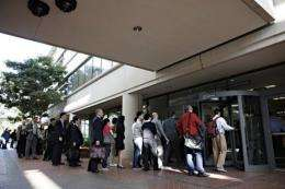 Individuals line up to watch Apple and Samsung face each other in federal district court in San Jose, California in July