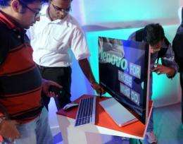 Journalists inspect the new Lenovo Ideacentre A720 at a launch function in Mumbai