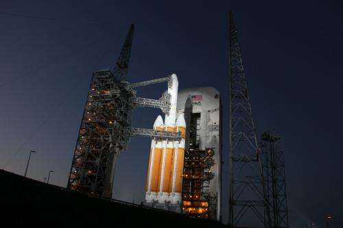 Mighty Delta 4 heavy rocket and Clandestine satellite poised at pad