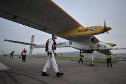 Pilot Andre Borschberg walks to the Swiss sun-powered aircraft Solar Impulse before takeoff in Payerne