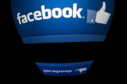 """The """"Facebook"""" logo is seen on a tablet screen on December 4, 2012 in Paris"""