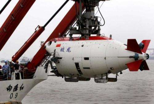 "The ""Jiaolong"" craft dived 7,015 metres in the Mariana Trench in the western Pacific Ocean on Sunday"