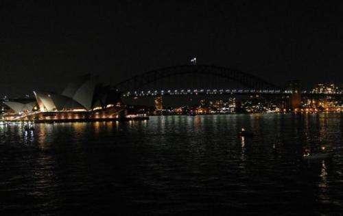 The Sydney Opera House and the Sydney Harbour Bridge are darkened