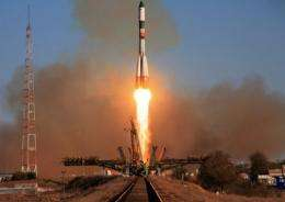 This file photo shows a Russian unmanned cargo spacecraft Progress M-13M blasting off from Baikonur