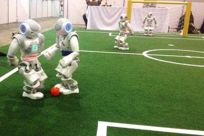 University of Texas at Austin team wins robot soccer world championships in 2 divisions