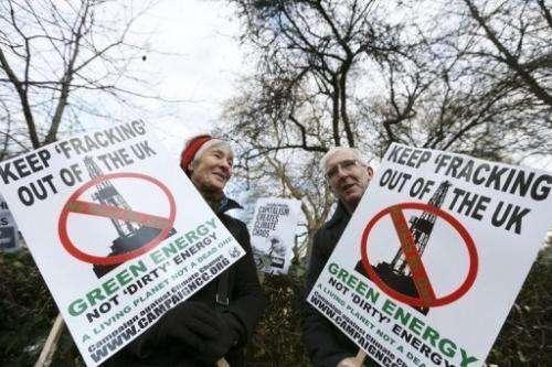 Demonstrators protest against 'fracking' outside the US Embassy in London on December 1, 2012