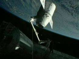 The International Space Station holds the SpaceX Dragon capsule on May 25