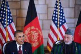 US President Barack Obama (L) speaks before signing a strategic partnership agreement with Afghan President Hamid Karzai