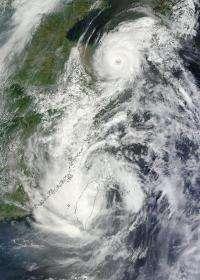 NASA satellites see Tropical Storm Saola and Typhoon Damrey arm-in-arm near China
