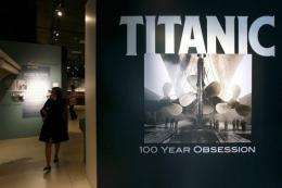 """Members of the press view exhibits during a media preview of a new exhibit """"Titanic: 100 Year Obsession"""""""