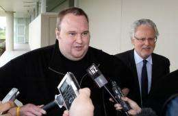 Megaupload boss Kim Dotcom leaves court after he was granted bail in the North Shore court in Auckland in February