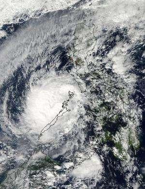 NASA satellites analyze Typhoon Bopha inside and out