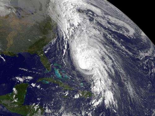 Satellite sees large Hurricane Rafael battering Bermuda
