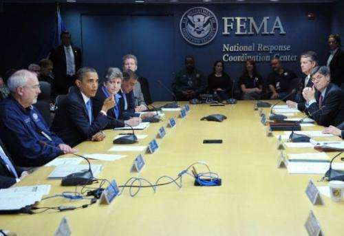 US President Barack Obama (L) takes part in a meeting at FEMA headquarters