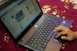A Bangladeshi woman logs onto social networking website Facebook on her laptop in Dhaka in May