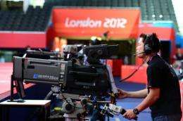 A cameraman tests his equipment one day before the start of the London 2012 Olympic Games