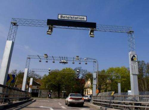 A car passes a congestion tax control point in Stockholm on May 12, 2006