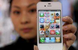 A Chinese worker shows an iPhone 4S