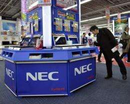 A customer inspects laptops from Japanese electronics maker NEC at an electrics shop in Tokyo in January