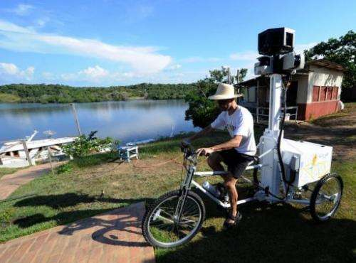 """A Google team member rides a Trike with a 360-degree camera system on it, to record the """"Street View for the Amazon"""""""