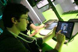 A man checks out the tablet friendly mobile operating system Android 3.0