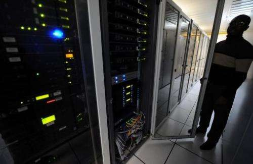 A man checks servers in a data center