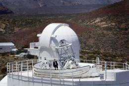 A man stands atop the German Solar Telescope GREGOR