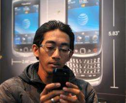 A man uses his Blackberry smartphone in Jakarta last week