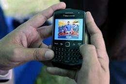 A man uses the new application for mobile phones of Venezuelan opposition candidate, Henrique Capriles Radonsk