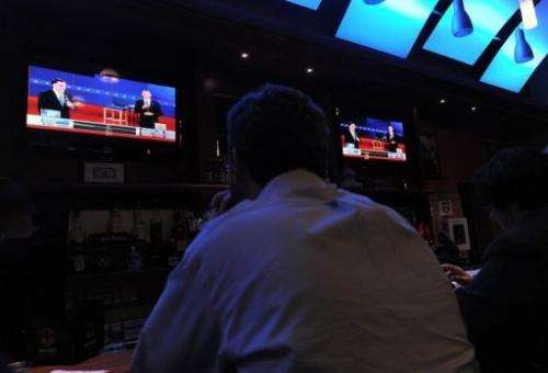 A man watches the second presidential debate