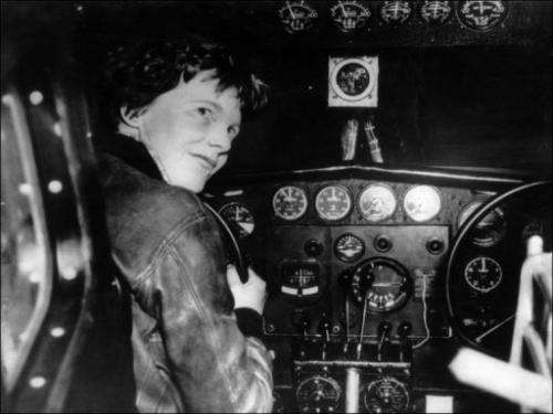 American aviator Amelia Earhart sits at the controls of her plane in the 1930s