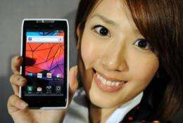A model from Motorola Mobility Japan shows off the company's new smartphone, 'Motorola Razr'