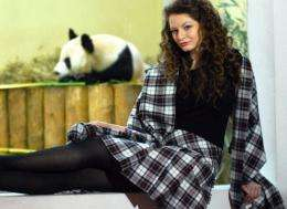 A model poses wearing a tartan designed in the honour of the two giant panda's recently acquired by Edinburgh Zoo