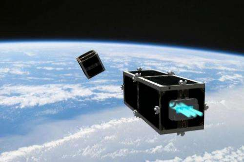 An artist's impression of a CleanSpace One satelite chasing a piece of debris