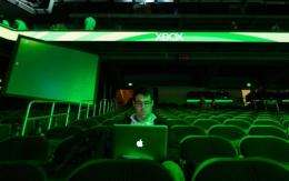 An attendee works on his computer after the Microsoft Xbox press conference