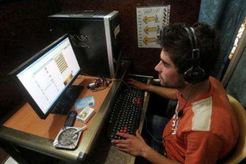 An Iraqi man uses a computer at an Internet cafe in Baghdad