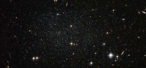 Antlia dwarf galaxy peppers the sky with stars