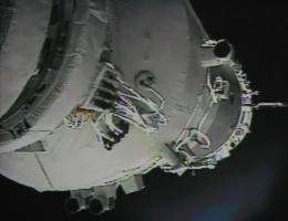 A photo of the giant screen at the Jiuquan space center shows the Shenzhou-9 spacecraft undergoing the automatic docking
