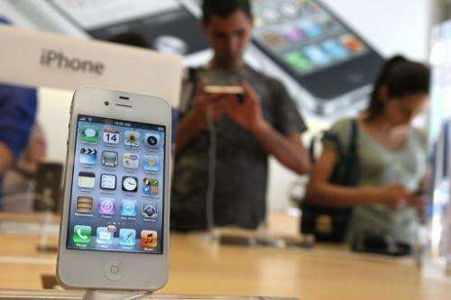 "Apple has hinted at a keenly anticipated ""iPhone 5"" in invitations that bore the cryptic message ""It's almost here"""