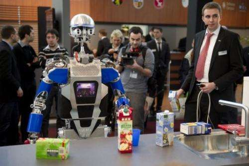 A robot said to be able to cook is on display at CeBIT, the world's biggest high-tech fair