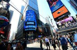 A sign announcing the Facebook IPO is flashed on a screen outside the NASDAQ stock exchange