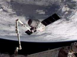 Astronauts enter world's 1st private supply ship (AP)