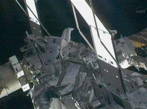 Astronauts take spacewalk to find ammonia leak