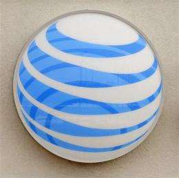 AT&T posts 4Q loss on charges; revenue increases (AP)